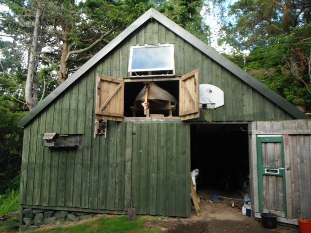 28) BOAT IN SHED